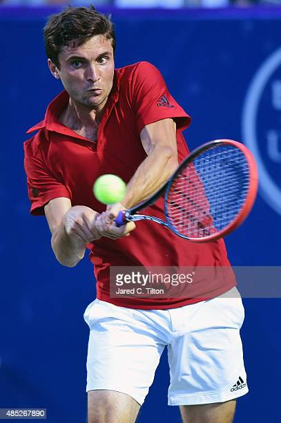 Gilles Simon of France returns a shot from Aljaz Bedene of Great Britain during the second day of the Winston-Salem Open at Wake Forest University on...