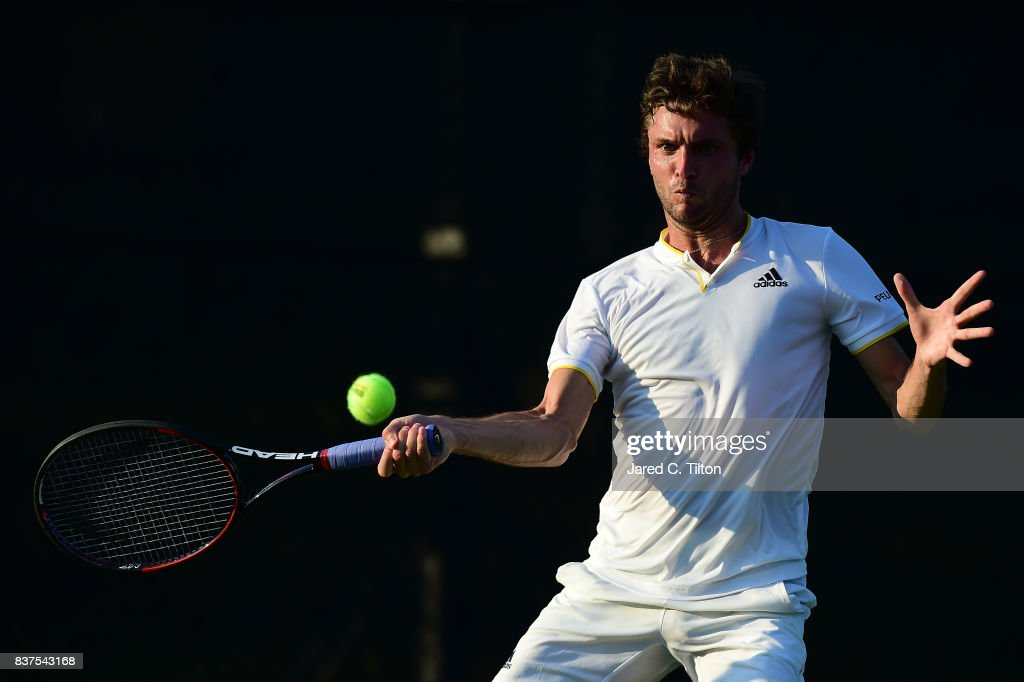 Gilles Simon of France returns a shot from Damir Dzumhur of Bosnia during the fourth day of the Winston-Salem Open at Wake Forest University on August 22, 2017 in Winston-Salem, North Carolina.