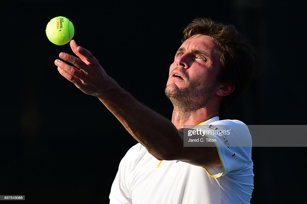 Gilles Simon of France serves to Damir Dzumhur of Bosnia during the fourth day of the Winston-Salem Open at Wake Forest University on August 22, 2017 in Winston-Salem, North Carolina.