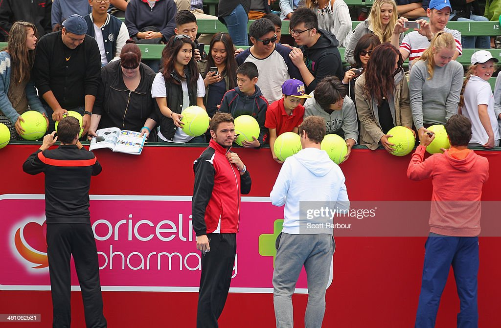 Gilles Simon of France, Stanislas Wawrinka of Switzerland, Richard Gasquet of France and Fernando Verdasco of Spain sign autographs for supporters during a press conference ahead of the AAMI Classic at Kooyong on January 7, 2014 in Melbourne, Australia.