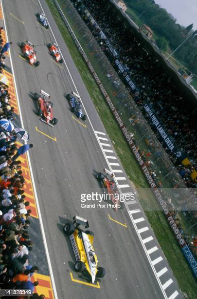 Gilles Villeneuve and Didier Pironi aboard their Scuderia Ferrari 126CK Ferrari V6s await the start behind Alain Prost on pole position in the Equipe...