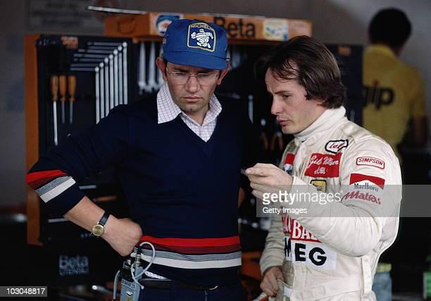 Gilles Villeneuve driver of the Scuderia Ferrari SpA SEFAC Ferrari 312T4 talks with Motor Sport Director of Ferrari Marco Piccinini during practice...