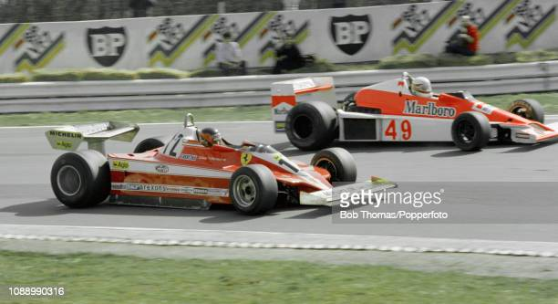 Gilles Villeneuve of Canada driving the Williams FW and Giacomo Agostini of Italy driving the Ferrari 312T3 during the Race of Champions at the...
