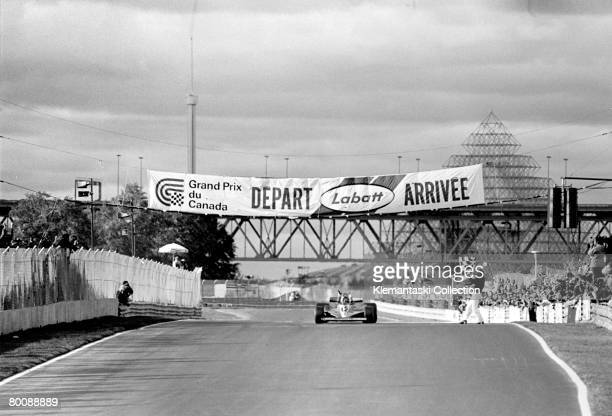 Gilles Villeneuve takes the checkered flag in his Ferrari 312T3 at the end of the Canadian Grand Prix, Ile Notre-Dame , 8th October 1978. It was the...