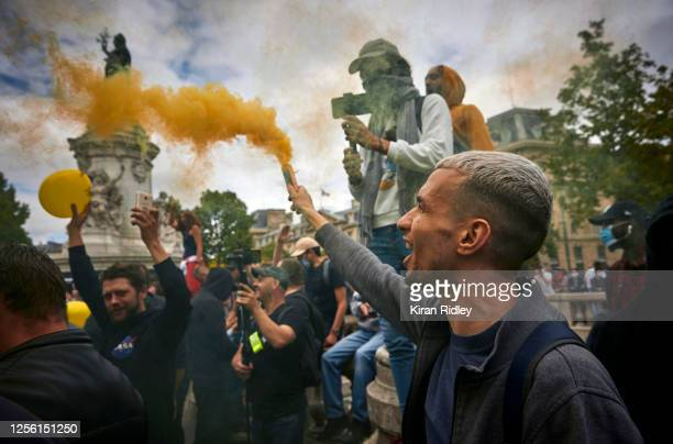 Gillet Jaune protestors demonstrate against President and his government during an antigovernment rally on Bastille Day at Place de la Republique on...