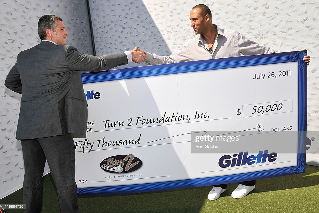 Gillette Presents Derek Jeter With $50,000 Donation For The Turn 2 Foundation In Honor Of His 3,000th Career Hit : News Photo