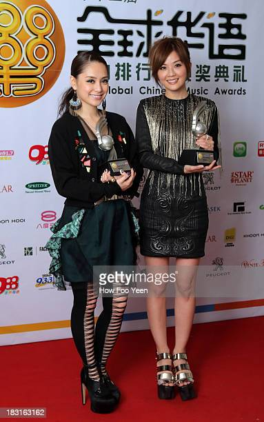 Gillian and Charlene Choi of Hong Kong with their Most Talented Artiste Awards poses at back stage during the 13th Global Chinese Music Awards at...