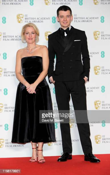 Gillian Anderson and Asa Butterfield pose in the Winners Room at the EE British Academy Film Awards 2020 at Royal Albert Hall on February 2, 2020 in...