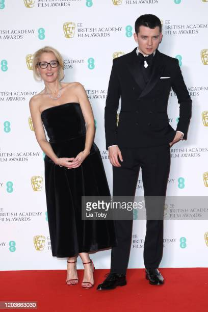 Gillian Anderson and Asa Butterfield pose in the Winners Room during the EE British Academy Film Awards 2020 at Royal Albert Hall on February 02 2020...