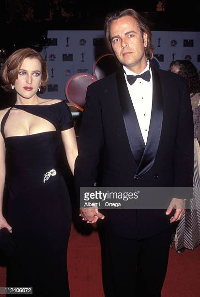 Gillian Anderson and Chris Stone during 3rd Annual Screen Actors Guild Awards at Shrine Exposition Center in Los Angeles California United States