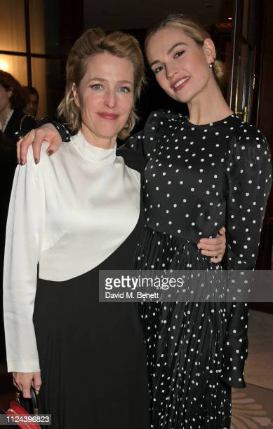 Gillian Anderson and Lily James attend the press night after party for 'All About Eve' at The Waldorf Hilton on February 12 2019 in London England