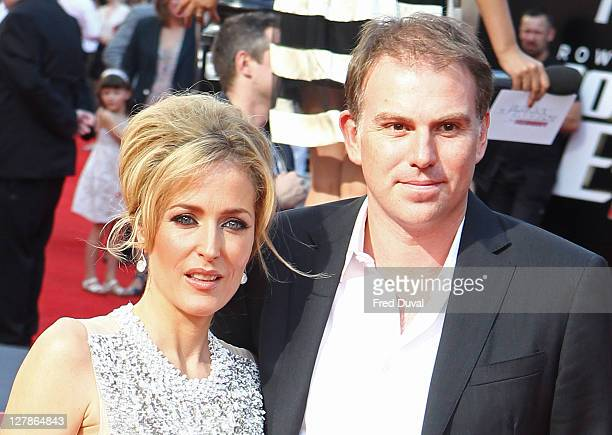 Gillian Anderson and Mark Griffiths attend the UK premiere of Johnny English Reborn at Empire Leicester Square on October 2, 2011 in London, England.