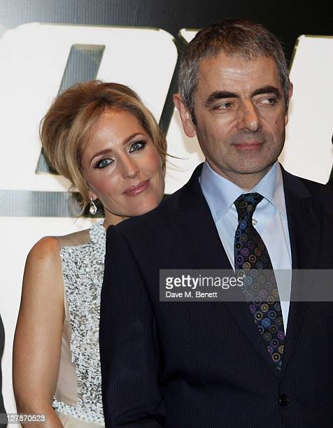 Gillian Anderson and Rowan Atkinson arrive at the UK Premiere of 'Johnny English Reborn' at Empire Leicester Square on October 2 2011 in London...