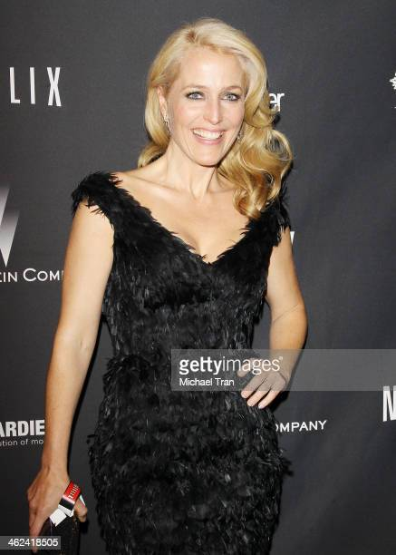 Gillian Anderson arrives at The Weinstein Company and NetFlix 2014 Golden Globe Awards after party held on January 12 2014 in Beverly Hills California