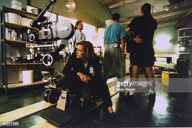 Gillian Anderson costar of cult hit TV series The XFiles sitting on camera dolly in between filming on the set of the show