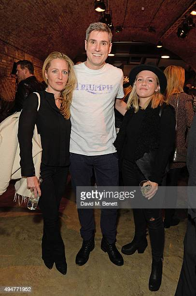 Gillian Anderson Nick Bloor and Piper Klotz attend the Global Triumph Bonneville launch on October 28 2015 in London England
