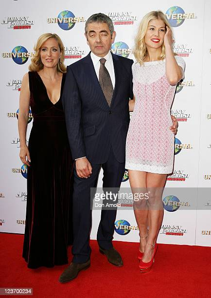"""Gillian Anderson,Rowan Atkinson and Rosemund Pike attend the world premiere of the movie """"Johnny English Reborn"""" at Fox Studios on September 4, 2011..."""