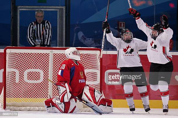Gillian Apps and Cherie Piper of Canada celebrate Apps' goal in the first period in front of Irina Gashennikova of Russia during the women's ice...