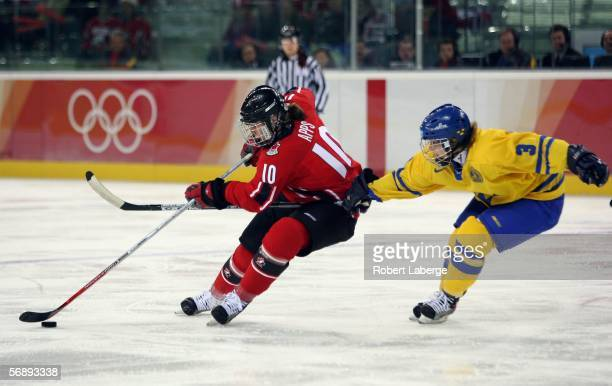 Gillian Apps of Canada and Frida Nevalainen of Sweden fight for the puck during the final of the women's ice hockey during Day 10 of the Turin 2006...