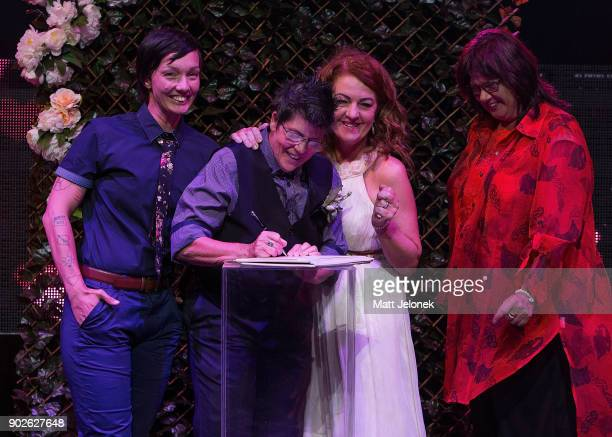 Gillian Brady and Lisa Goldsmith sign their marriage certificate at The Court on January 9 2018 in Perth Australia Couples across Australia wed in...