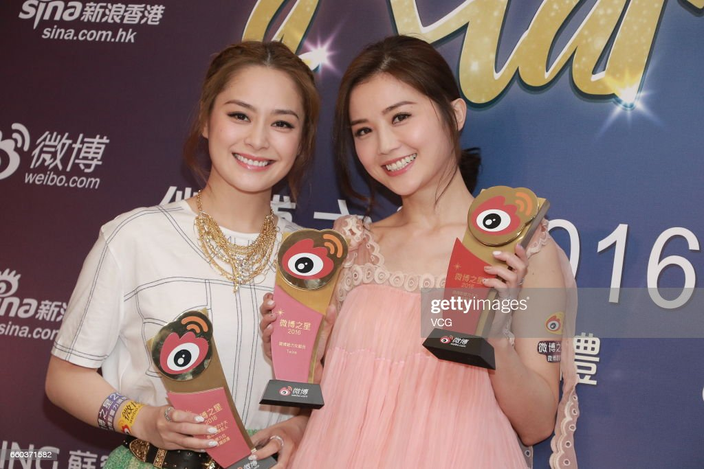 Gillian Chung (L) and Charlene Choi of girl group Twins pose with their trophies during 2016 Hong Kong Weibo Star Awards Ceremony on March 29, 2017 in Hong Kong, China.