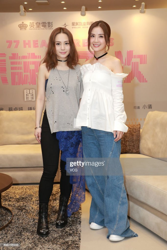 Gillian Chung (L) and Charlene Choi of girl group Twins promote director Herman Yau Lai-To's film '77 Heartbreaks' on June 6, 2017 in Hong Kong, China.