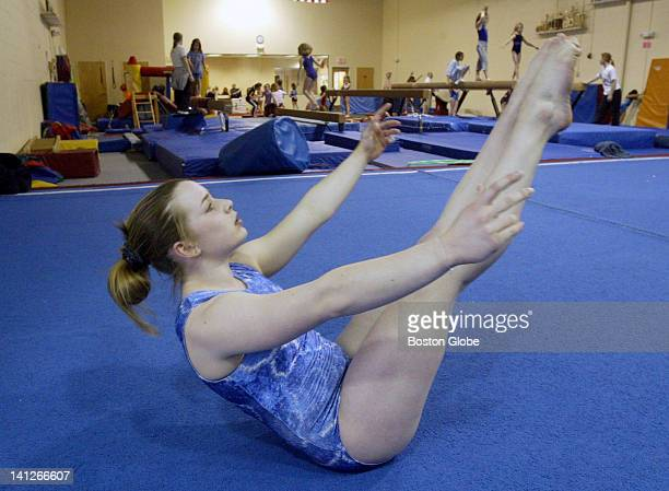 Gillian Coleman of Brookline the state's best high school gymnast practices at Exxcel Gymnastics in Newton Mass
