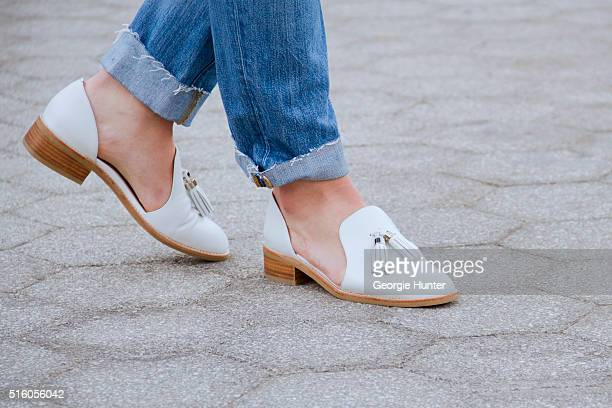 Gillian Del Zotto wearing ripped J Brand Jeans and white leather Jeffrey Campbell shoes with tassels on March 16 2016 in New York City