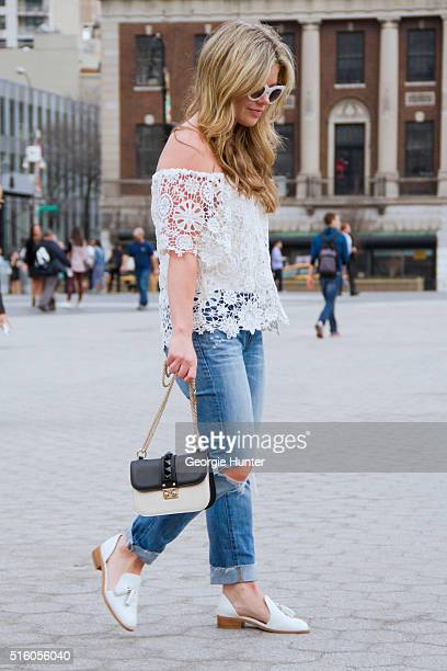 Gillian Del Zotto wearing ripped J Brand Jeans white lace Nightcap Clothing top white leather Jeffrey Campbell shoes with tassels black and white...