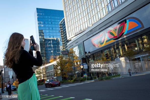 Gillian Dunn of Boston takes a photo of Frank Stella's mural reproduction of his 1970 painting Damascus Gate along Seaport Boulevard in Boston on Oct...