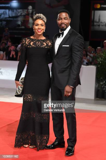 Gillian Iliana Waters and Michael Jai White walk the red carpet ahead of the 'Dragged Across Concrete' screening during the 75th Venice Film Festival...