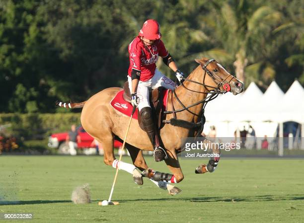 Gillian Johnston of CocaCola hits the ball with the mallet as she rides up field against Tackeria during sixth chukker of the Herbie Pennell Cup on...
