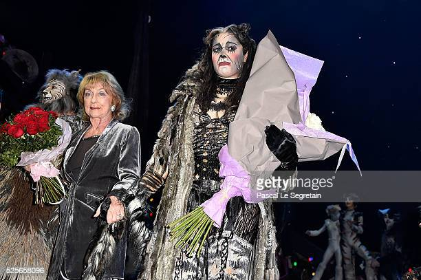 Gillian Lynne and Chimene Badi pose on stage with dancers during the Cats Premiere at Theatre Mogador on April 28 2016 in Paris France