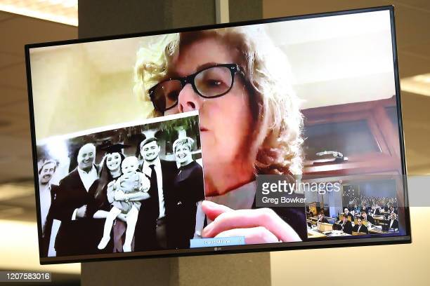 Gillian Millane holds a family photograph during her televised victim impact statement from her home in the UK on February 21 2020 in Auckland New...
