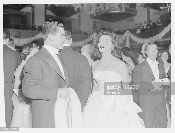 Gilligan's Island star, Tina Louise, who also starred in Broadway's Li'l Abner, at the Tiara Ball with her escort in 1952.