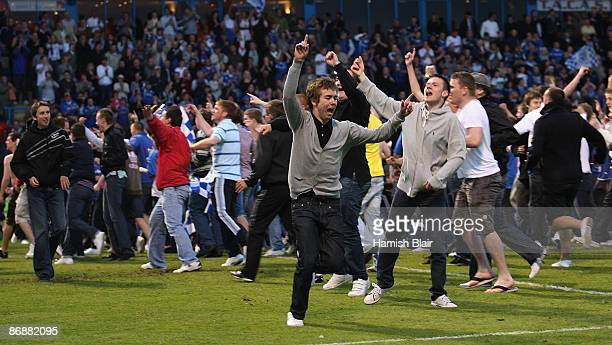 Gillingham fans run on to the pitch on the final whistle to celebrate their team's victory during the Coca Cola League Two Play-off Semi Final Second...