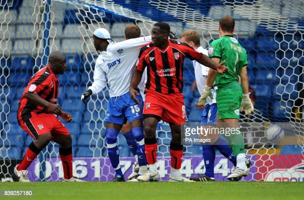 Gillingham's Adebayo Akinfenwa scores their third goal during the npower League Two match at Gigg Lane Bury