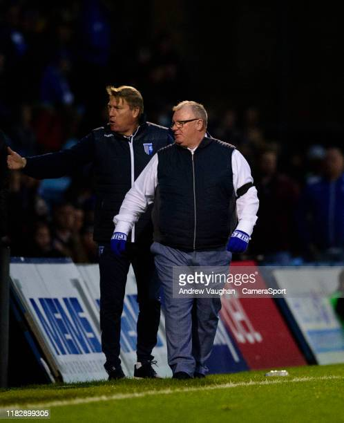 Gillingham's assistant manager Paul Raynor left and Gillingham manager Steve Evans shout instructions to their team from the technical area during...