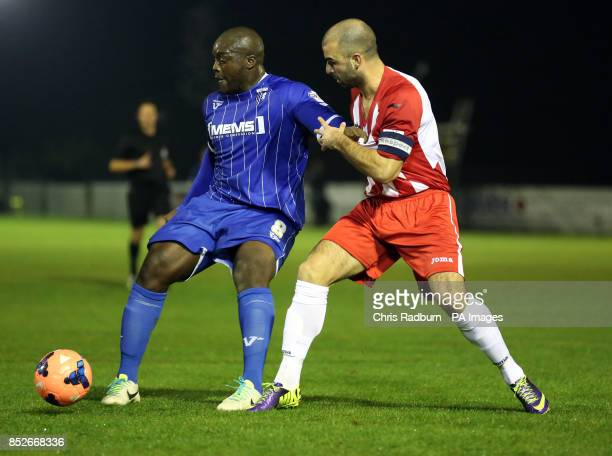 Gillingham's Bayo Akinfenwa holds off Brackley Town's Ryan Austin during the FA Cup First Round Replay at St James Park Brackley