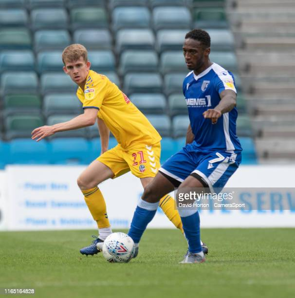 Gillingham's Brandon Hanlan under pressure from Gillingham's Joe Walsh during the Sky Bet League One match between Gillingham and Bolton Wanderers at...