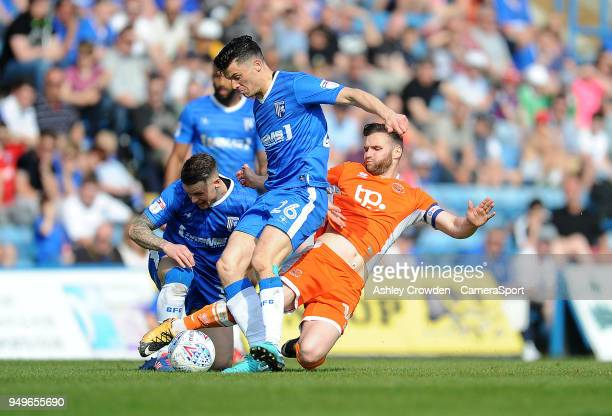 Gillingham's Callum Reilly is tackled by Blackpool's Jimmy Ryan during the Sky Bet League One match between Gillingham and Blackpool at Priestfield...