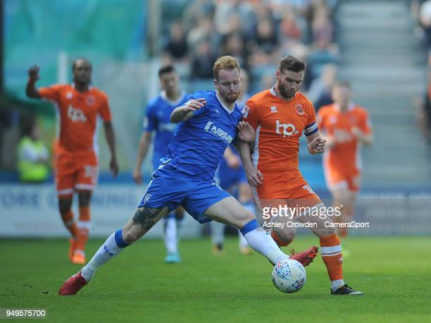 Gillingham's Connor Ogilvie battles with Blackpool's Jimmy Ryan during the Sky Bet League One match between Gillingham and Blackpool at Priestfield...