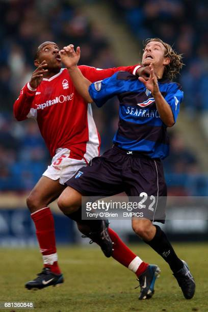 Gillingham's Danny Spiller and Nottingham Forest's Andy Impey keep their eyes on the ball