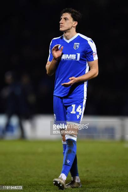 Gillingham's English defender Alfie Jones applauds supporters on the pitch after the English FA Cup third round football match between Gillingham and...