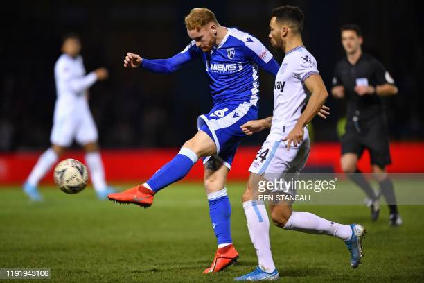 Gillingham's English defender Connor Ogilvie has this shot easily saved during the English FA Cup third round football match between Gillingham and...