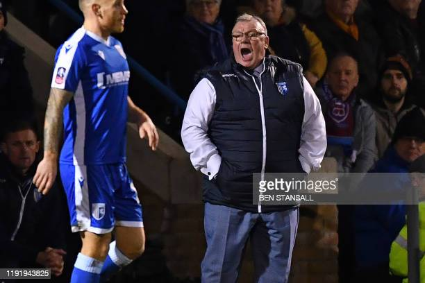 Gillingham's English manager Steve Evans gestures on the touchline during the English FA Cup third round football match between Gillingham and West...