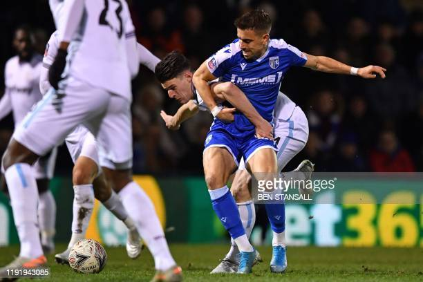 Gillingham's English midfielder Olly Lee is fouled by West Ham United's English midfielder Declan Rice during the English FA Cup third round football...