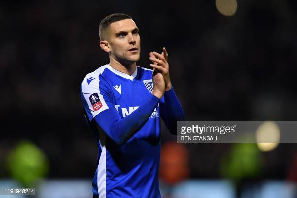 Gillingham's English midfielder Stuart O'Keefe applauds supporters on the pitch after the English FA Cup third round football match between...