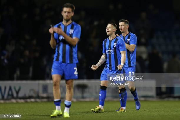 Gillingham's Irish midfielder Mark Byrne and Gillingham's Englishborn Irish midfielder Callum Reilly celebrate on the pitch after the English FA Cup...