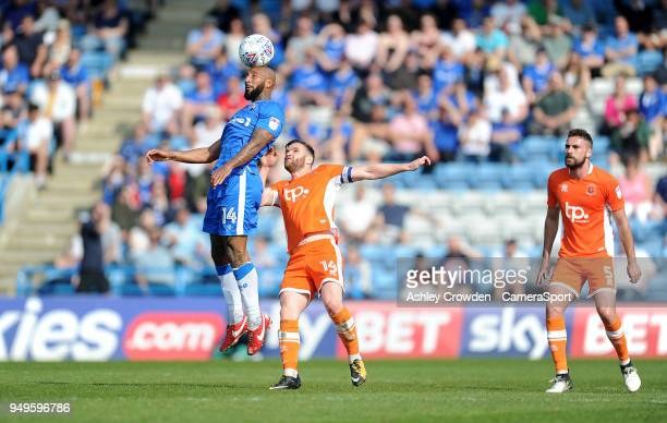 Gillingham's Josh Parker vies for possession with Blackpool's Jimmy Ryan during the Sky Bet League One match between Gillingham and Blackpool at...